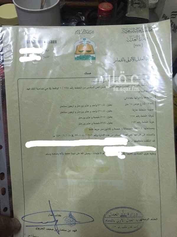 1333597 ارض للبيع في ضاحية الملك فهد الخي السادس على شارع الملك سعود