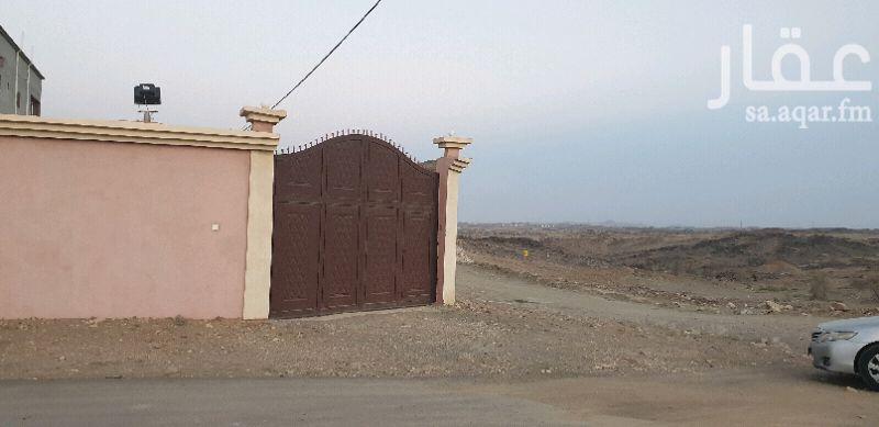 1157748 ارض محوشه على شارعين بصك فيها بيت شعبي  وخزان