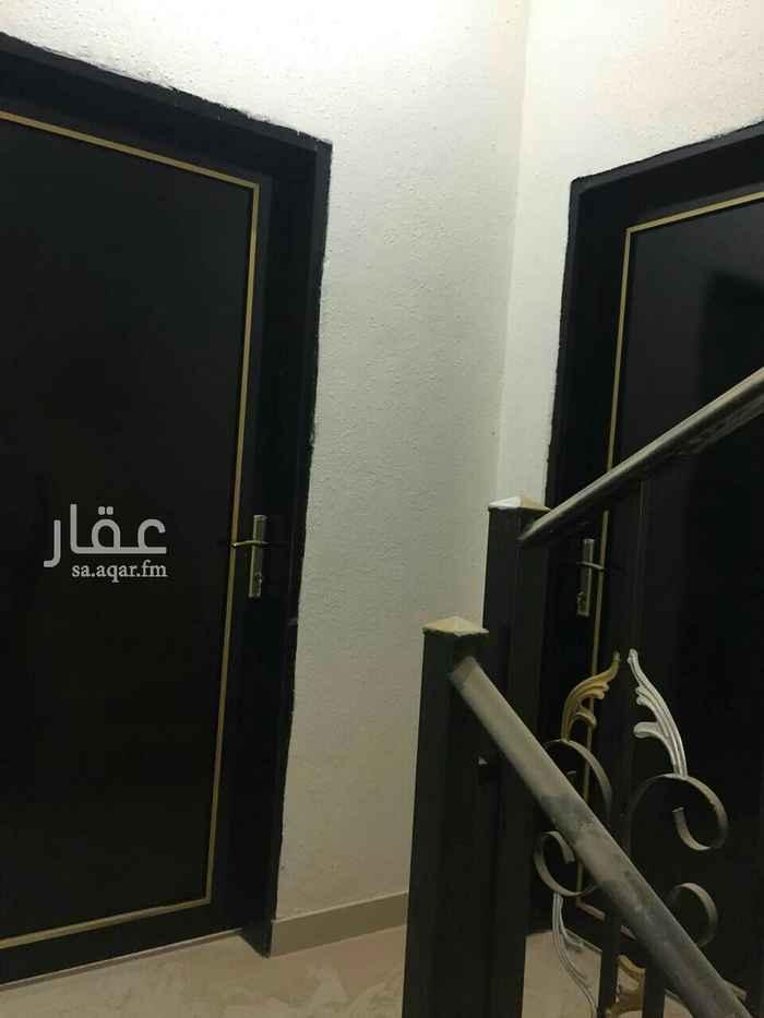 1811714 الشقة مدخلين رجال ونساء ومجلس وصالة وغرفتين وحمامين ومطبخ  موقع الشقه بالمعالي