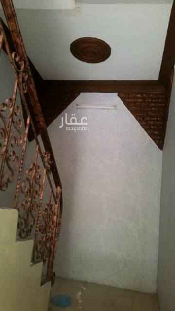 1749546 شقه بحي الجزيره ثلاث غرف وصاله دور ثاني بعداد كهرباء مستقل... المالك يرغب بعائله صغيره
