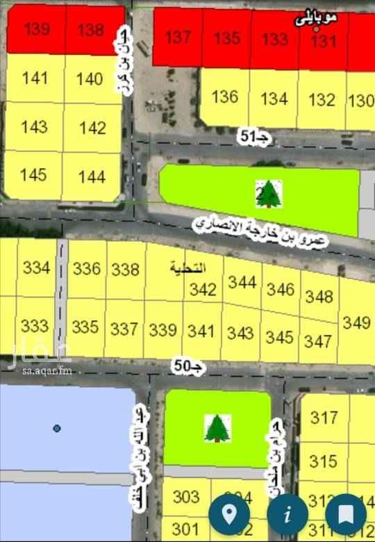 1767202 مخطط الثنيانيه ارض زاويه شارع ونافذ امامها حديقه وقريبه من بنده وقريبه من المسجد