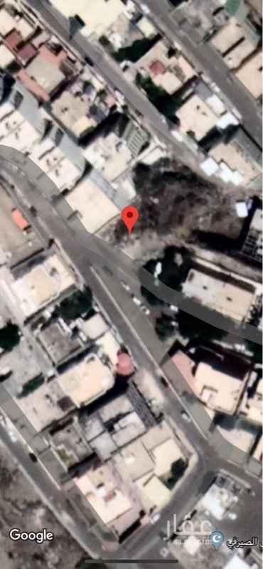 1354533 قطعه ارض سكنيه بحي الربوة ممكله بصك الكتروني ومطله على حديقه