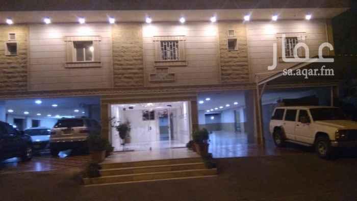 1650255 شقة مكونة من 2 غرفة 2 صالة 2 حمام و مطبخ موقع مميز موقف خاص بجوار جامع ام القرى  حي الصفا 9 مخطط الشعلة عمارة جديدة