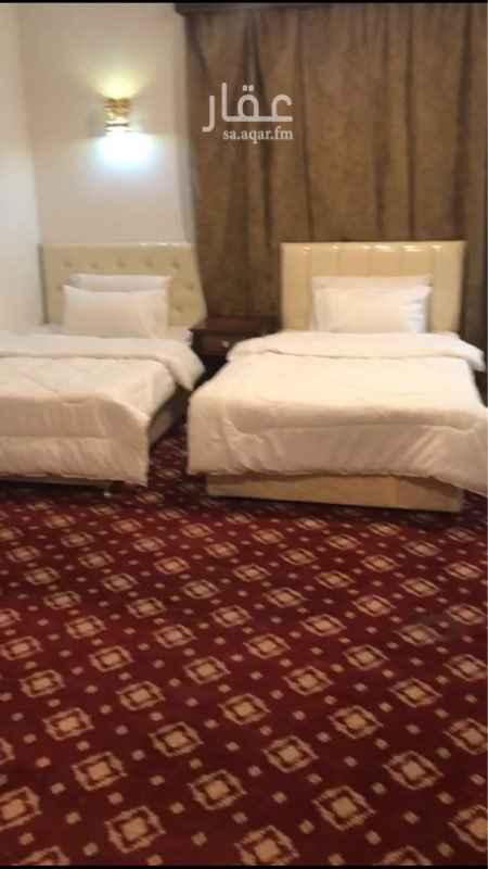 1583706 شقة مكونه من غرفتين وحمام ومطبخ تتسع لستة اشخاص الشقة في برج فاخر في حي اجياد خمسة دقائق سير على الاقدام للحرم المكي الشريف