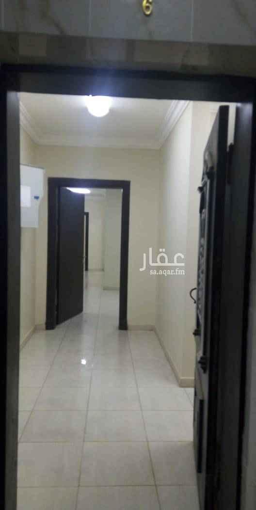 1499458 شقة سكنيه عوائل بحي المنار شارع ادريس السنوسي دور ارضي  أربع غرف وصاله ومطبخ وحمامين