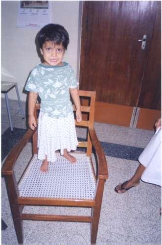 Orphan girl on chair