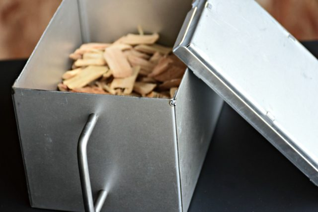 Electric smoker wood chip container