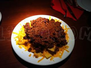 Media de nachos con chili
