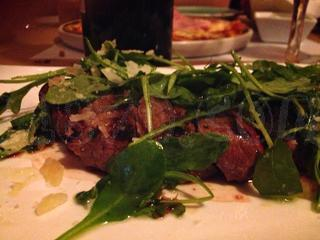 Tagliata charcoal veal with rocket and parmesan