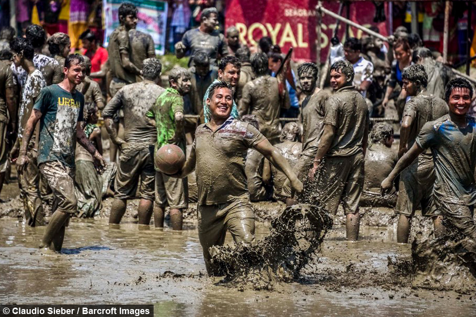 Nepalese Farmers Get Muddy At The Ropain Festival