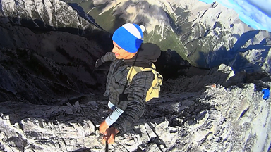 Risking An 8550ft Drop: Thrill seekers Walk Along Treacherous Mountain Ridge