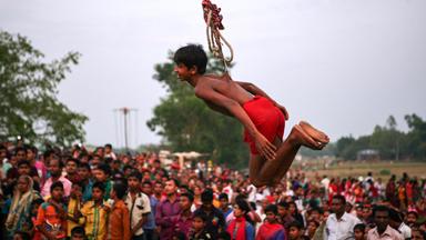 Hindu Festival Goers Use Flesh Hooks To Celebrate