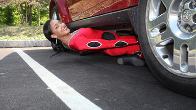 Reaching New Lows: Limbo Dancer Shimmies Under Car
