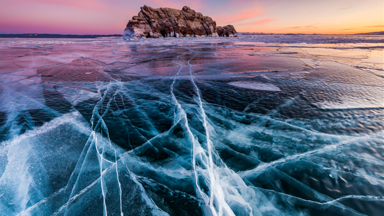 Photographer captures cracks in the ice of world's largest and oldest lake