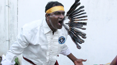What a mouthful! Meet the record breaking sword swallower