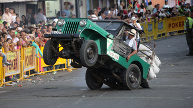 Wheelie Good: Overloaded Jeeps Bounce At Colombian Festival