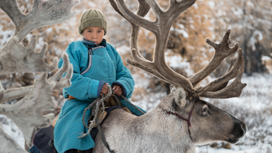 Navigate the snowy landscapes of Mongolia with this reindeer herding family
