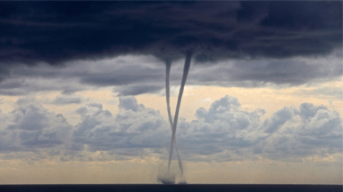 Twist and Spout! Twin Waterspouts Spin in the Ocean