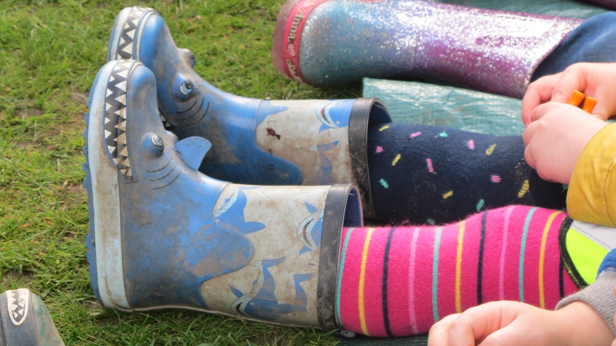 Children's legs in welly boots