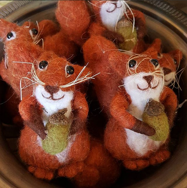 A display of cheerful squirrel Christmas decorations.