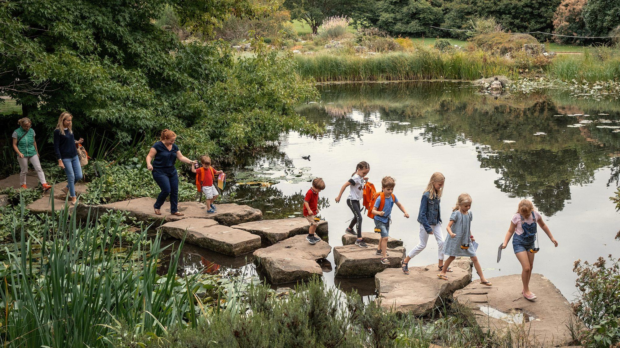 Children crossing the lake.