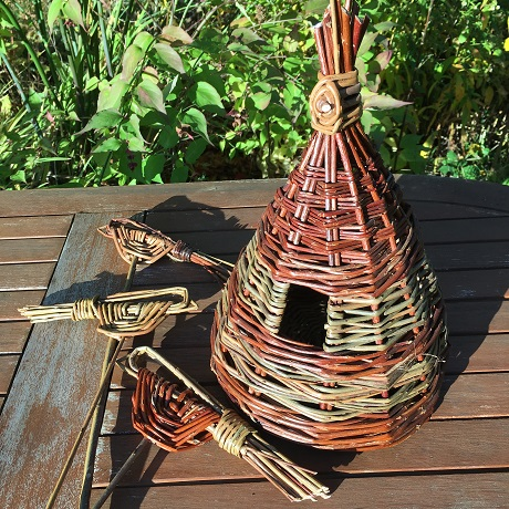Bi coloured conical willow bird house in brown and green with 3 willow birds on sticks