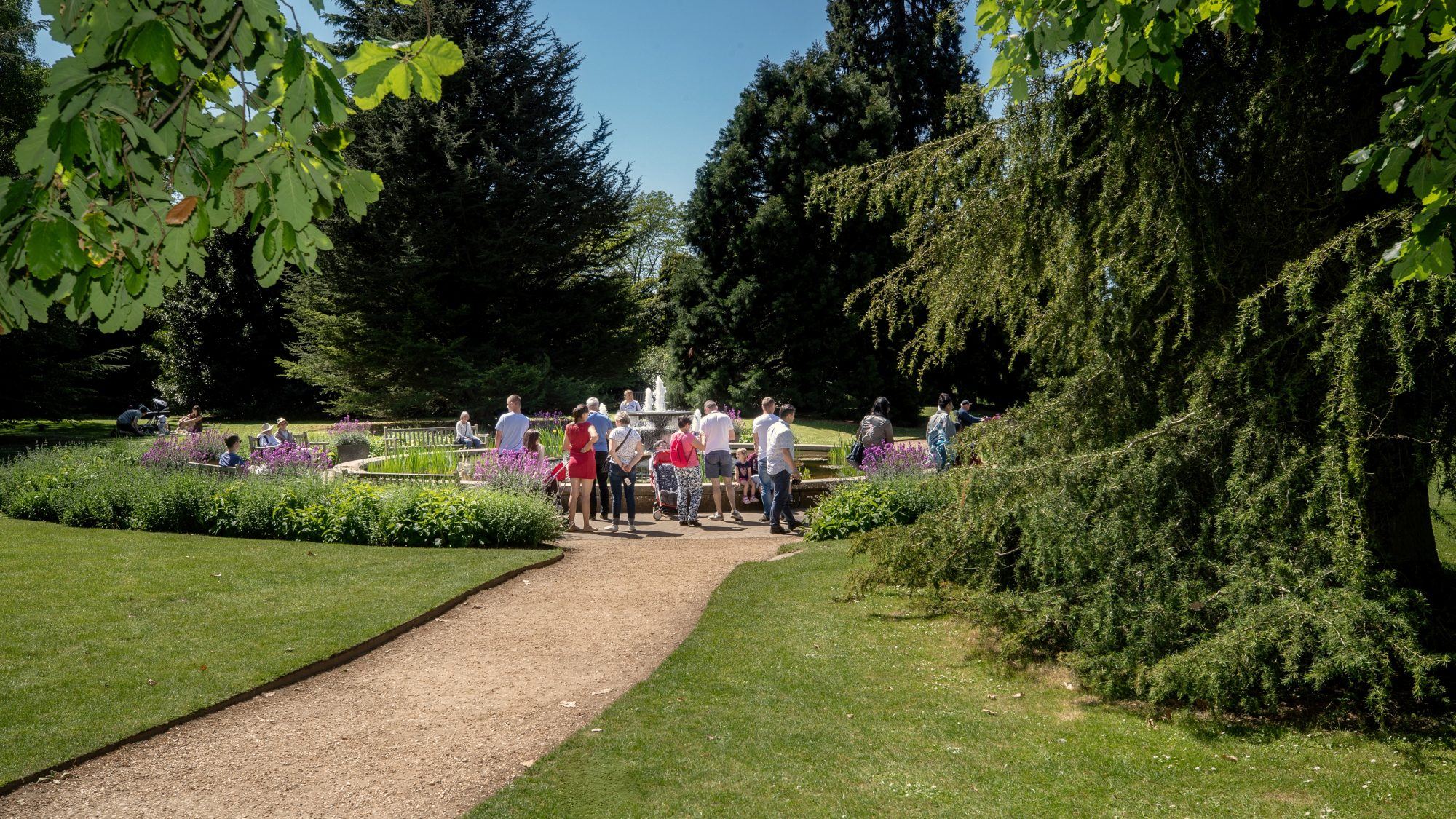 Visitors enjoying the main walk and iconic fountain, designed by David Mellor (1930-2009).