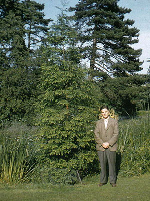 John Gilmour, Director of the Botanic Garden, in front of our Dawn Redwood in 1955.