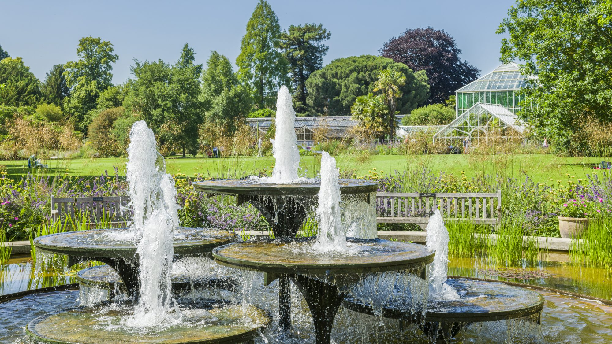 The iconic fountain designed by David Mellor (1930-2009), completed in 1970. Overlooking the main lawn on a bright day.