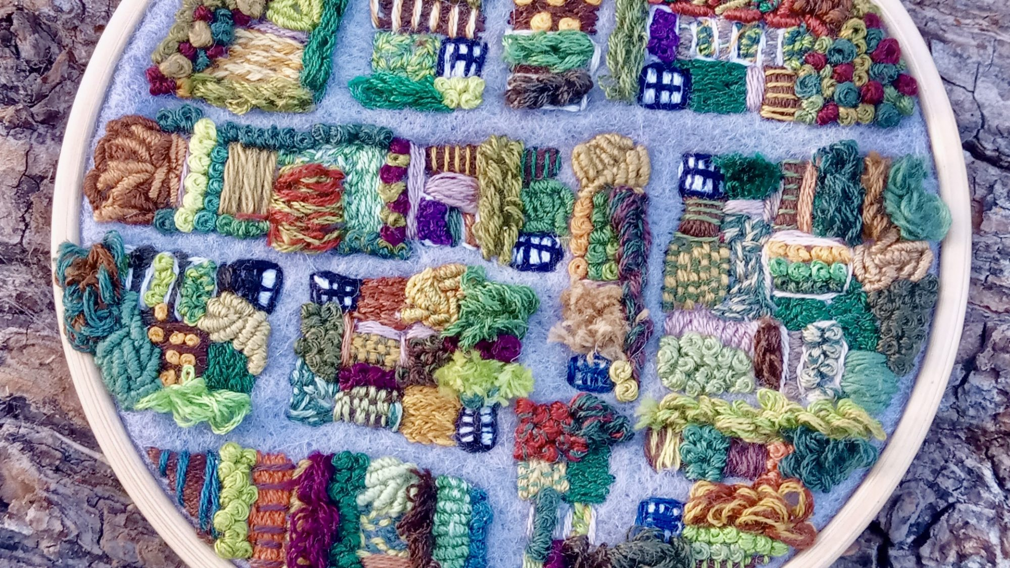 an allotment embroidered on a hoop