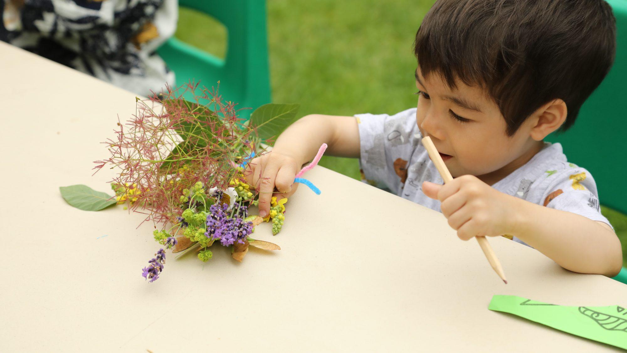Image of child making n nature craft