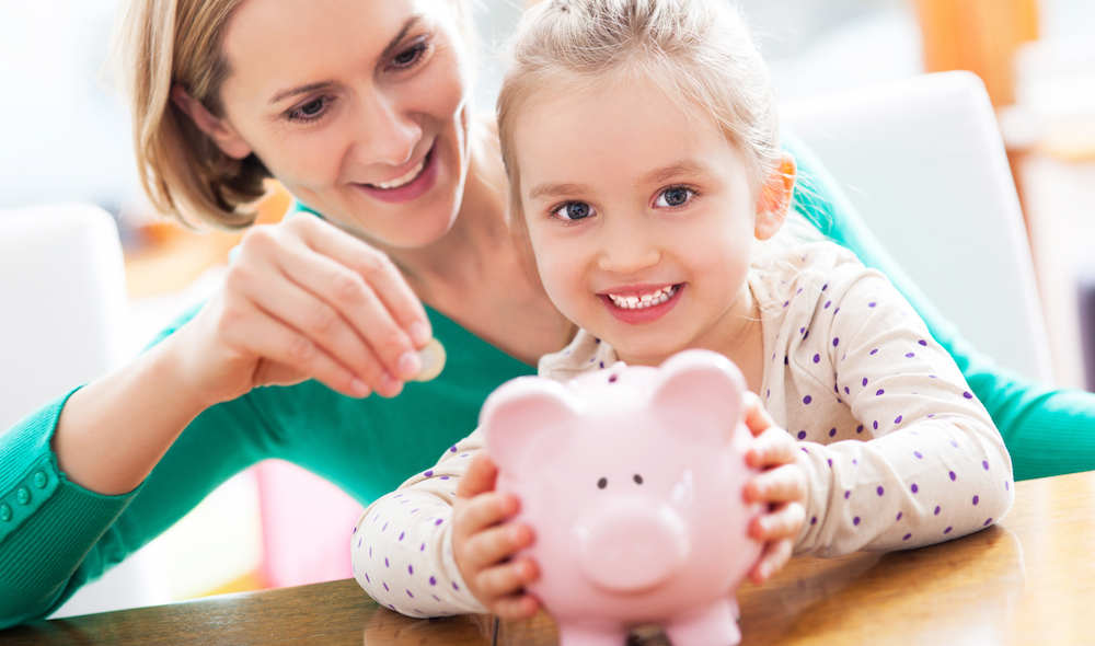 child and parent saving money