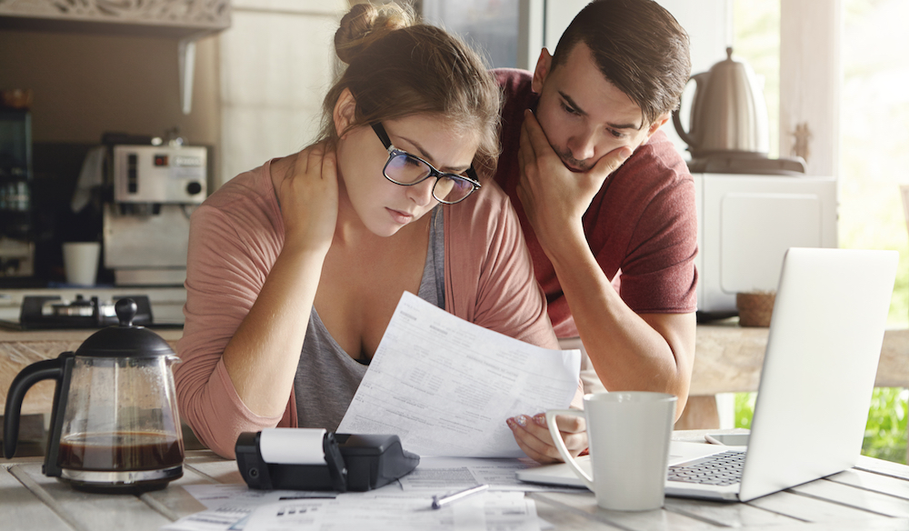 young couple dealing with debt