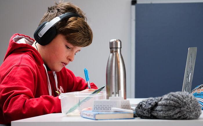 Boy at desk home schoolings