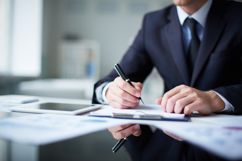 a solicitor signing a document