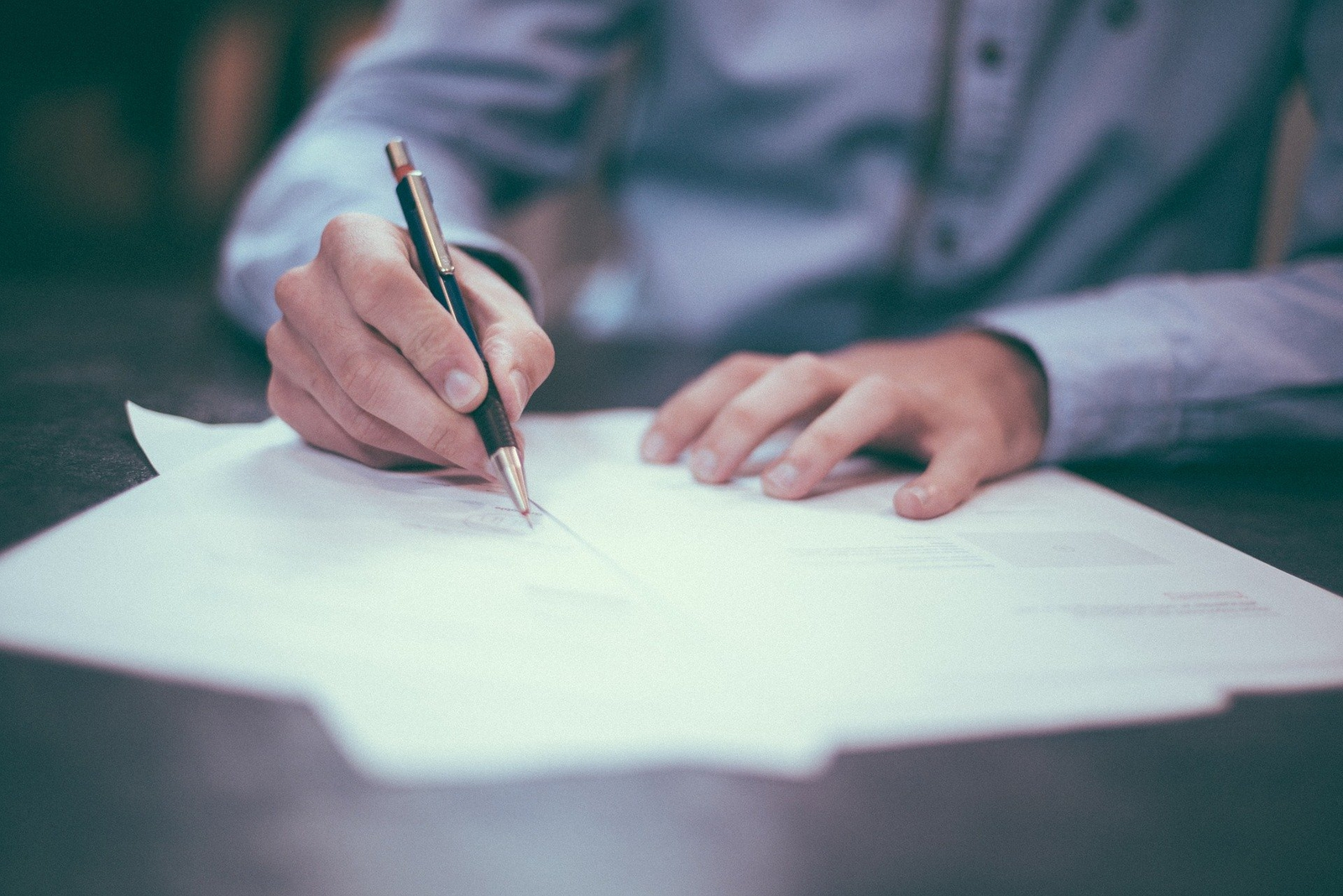 professional man signing a legal paper