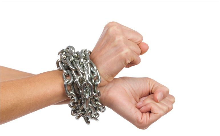 hands tied with a metal chain