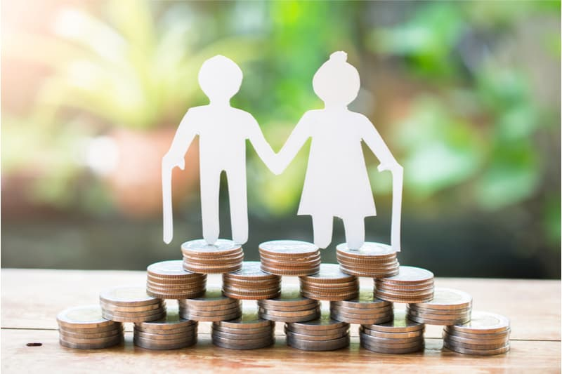man and woman standing on coins