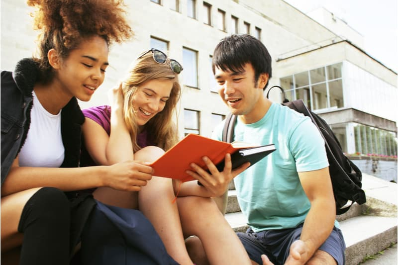 international students sitting and chatting happily
