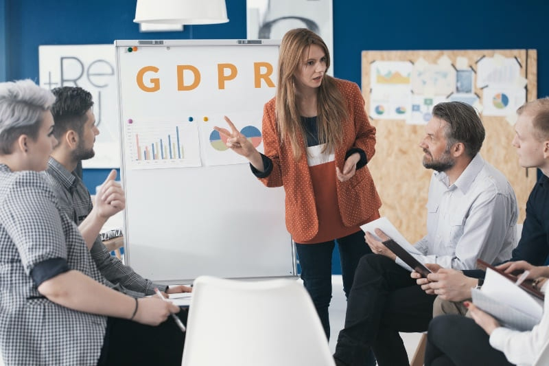 lady carrying out GDPR training on a whiteboard