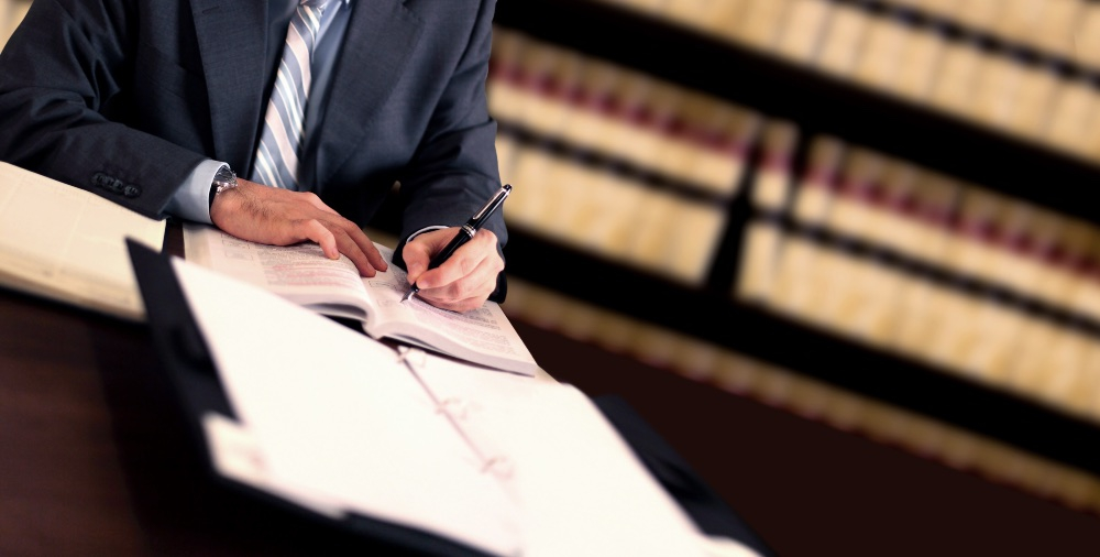 lawyer signing a settlement agreement