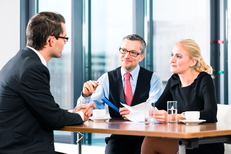 commercial lawyer giving advice to a couple