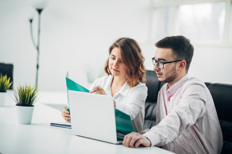 two company lawyers looking at a document