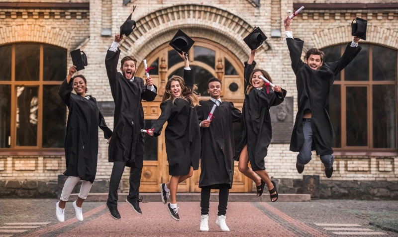 university students graduating wearing gowns