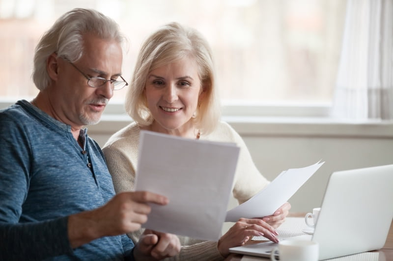 people looking at a pensions document