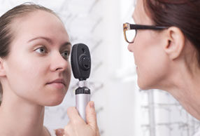Woman having an on site eye examination