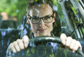 Woman driving while wearing driver glasses