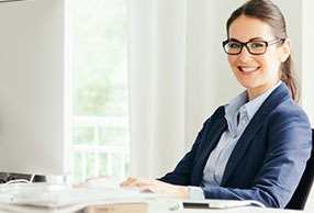 Woman at an office desk wearing VDU glasses