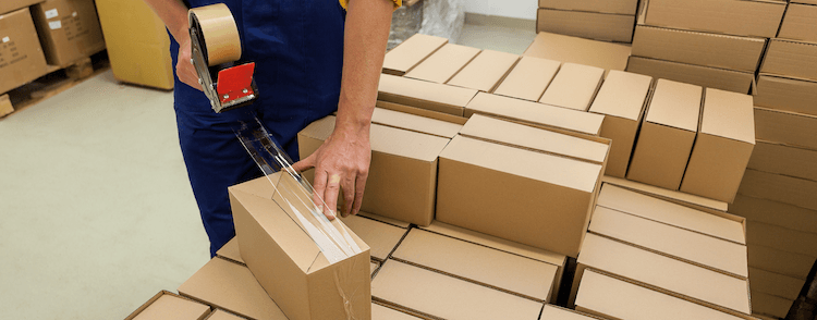 Fulfilment centre worker packaging products