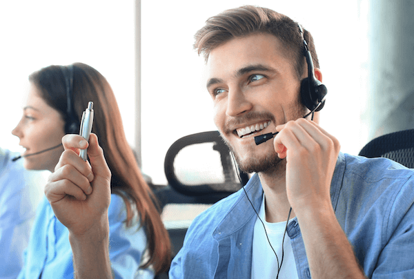 Man in call centre delivering customer service